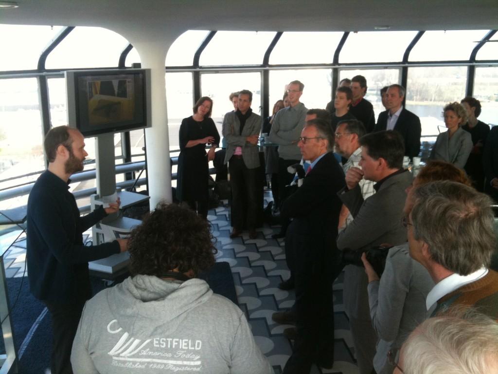 Klaas Nienhuis presenting AR stamp to audience